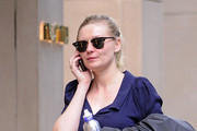 9646ea3cc78 Kirsten Dunst flashes a smile while out shopping at Miu Miu in New York.