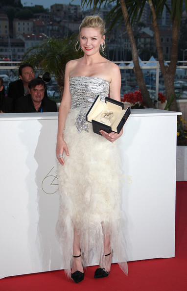 "Kirsten Dunst wins the best actress award for her role in Lars Von Trier's film ""Melancholia"" during the closing ceremony of the 64th Cannes Film Festival, held at the Palais des Festivals on the Croisette avenue in Cannes."