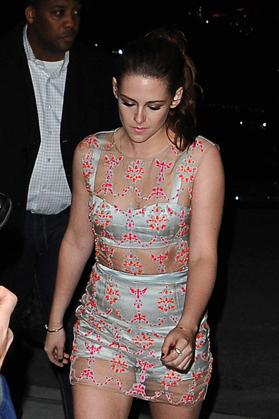 Kristen Stewart - Kirsten Stewart goes for a much more revealing look in a sheer Erdern dress and bright orange pumps, for the premiere of 'On the Road' in New York City