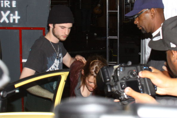 "Kristen Stewart, reluctant star of the ""Twilight"" saga, hides her face as she leaves the Troubadour music venue in West Hollywood."