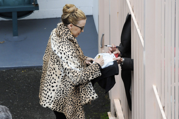 "Kylie Minogue Kylie Minogue wears a leopard print coat to greet her Sydney fans before her ""Aphrodite"" show. The Australian singer was at the Entertainment Centre and stopped to sign autographs before she takes to the stage later today."