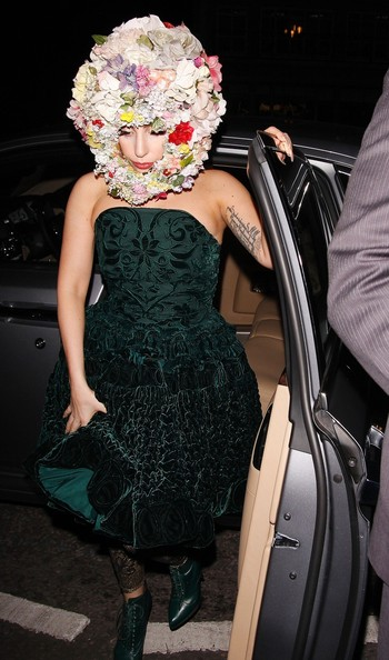 Lady Gaga wears a floral wreath around her head as she attends the Philip Treacy LFW catwalk show at the Royal Courts of Justice in London.