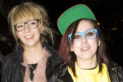 Big Brother reality show rejects, rapper Lady Sovereign and ex-Rolling Stone lover Ekaterina Ivanova wander down London's Oxford street with friends looking for a cab after a night out at Punk nightclub.