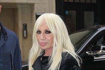 Legacy Fashion icon Donatella Versace, dressed in black from head to toe, makes her way around Soho in New York City