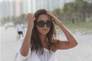Lily Fortescue Lily Fortescue takse advantage of the sun and lounges on the beach in Miami