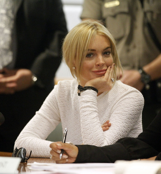 Lindsay Lohan Actress Lindsay Lohan in court with her Lawyer Shawn Chapman Holley for her arraignment at the Airport Courthouse. Lohan was charged with a felony count of grand theft for allegedly stealing a $2,500 necklace from a jewelry store in Venice. (Pool Photo).