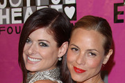 Debra Messing and Maria Bello pose for photographs at the 2010 Joyful Heart Foundation benefit gala, held at Skylight Soho downtown Manhattan.