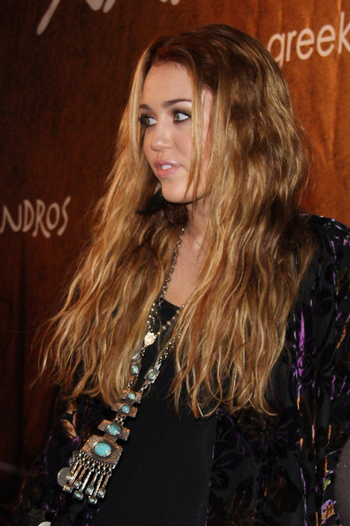 Miley Cyrus Miley Cyrus shows up at the grand opening of a new restaurant called Xandros in West Los Angeles.