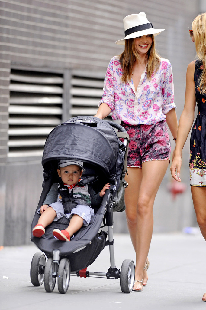 Miranda Kerr takes her baby son Flynn for a stroll in New York City. The supermodel was dressed fashionable as ever as she took her young son with husband Orlando Bloom (not pictured) out in the Big Apple.