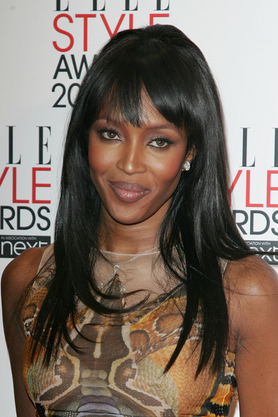 Naomi Campbell Naomi Campbell wears a snake print Alexander McQueen dress to the 2010 Elle Style Awards at the Grand Connaught Rooms in London.