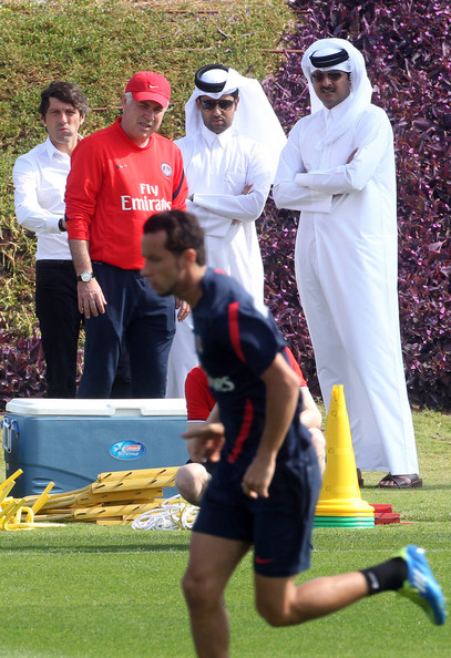 Nasser Al-Khelaifi - Crown Prince of Qatar and current heir apparent to the throne of the State of Qatar, Sheikh Tamim Bin Hamad Al-Thani watches his football club Paris Saint Germain during a training session with President of the club Nasser Al Khelaifi  and Director of foo