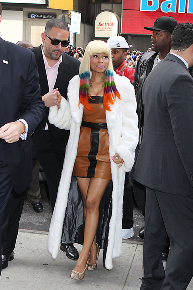Nicki Minaj Nicki Minaj dons a furry white coat and multicolored streaks in her hair as she arrives at a MAC event in Times Square, NYC.