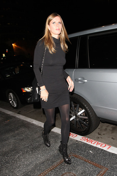 Nicky Hilton wears a slinky black dress to meet her sister Paris for dinner at Cleo restaurant.