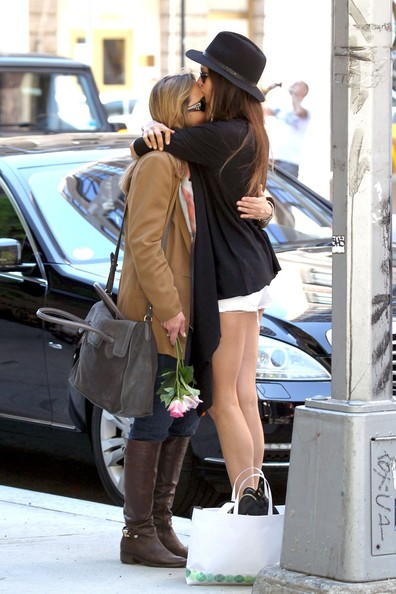 "Nina Dobrev, star of the hit TV series ""The Vampire Diaries"", is spotted giving her mother some flowers and a big kiss on the forehead while spending Mother's Day together."