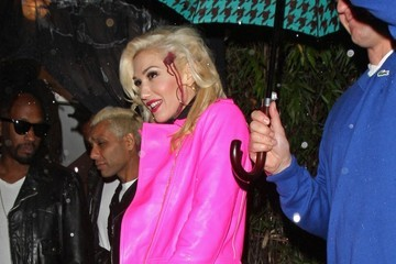 No Doubt Gwen Stefani and No Doubt band member Tony Kanal seen leaving in the rain from Jonathan Ross's Halloween party held at his home in London