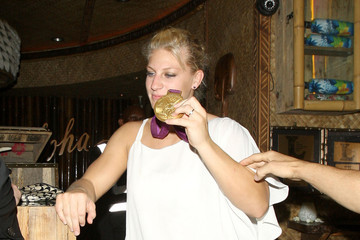 Olympian Kayla Harrison, the first American to win a gold medal in judo, rightfully shows off her medal while out at Mahiki nightclub in London