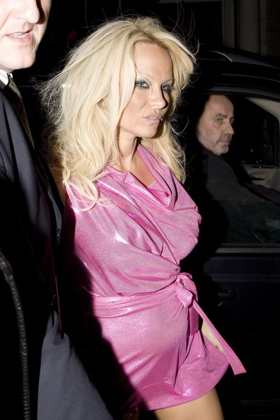Pamela Anderson is seen leaving the 'Whisky Mist' night club in Mayfair looking a bit worse for wear. Pamela apparently popped into the night club for ten minutes then left, headed for her hotel. She was wearing a very short pink dress and at one point could be seen trying to adjust it in the back.