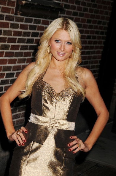 "Paris Hilton Celebrating her 30th birthday Paris Hilton appears on ""The Late Show with David Letterman"". After the show she shared a birthday kiss with her businessman boyfriend Cy Waits and posed outside the Ed Sullivan Theatre for the photographers."