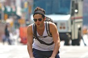 "Penn Badgley, dressed in a white tank top and blue pants, pedals way from an East Village gym in New York City. Badgley plays Dan Humphrey on the CW's ""Gossip Girl"", which enters its sixth and final season this fall."