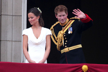 Pippa Middleton Sealed with a Royal Kiss! The Duke and Duchess of Cambridge embrace on the balcony at Buckingham Palace  after their earlier marriage at Westminster Abbey which was watched by 2 billion people