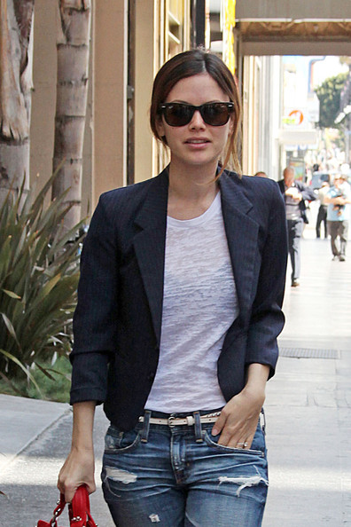 Rachel Bilson struts down Hollywood Blvd. in ripped baggy jeans and clogs, sporting a heathered white shirt and navy blazer as she heads into a building.