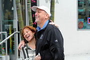 """""""Real Housewives of New Jersey"""" stars Caroline Manzo and Jacqueline Laurita spend the afternoon shopping in Miami with their families. Caroline, her husband Albert and 3 kids Albie, Chris and Lauren accompanied Jacqueline and her husband Chris as they browsed the shops on Ocean Drive before heading back to their hotel. The """"Real Housewives"""", who have reportedly moved in together after a storm left Jacqueline's house without power, are in town to launch their new company Blk Water, which is a bottled water, colored with black food dye."""