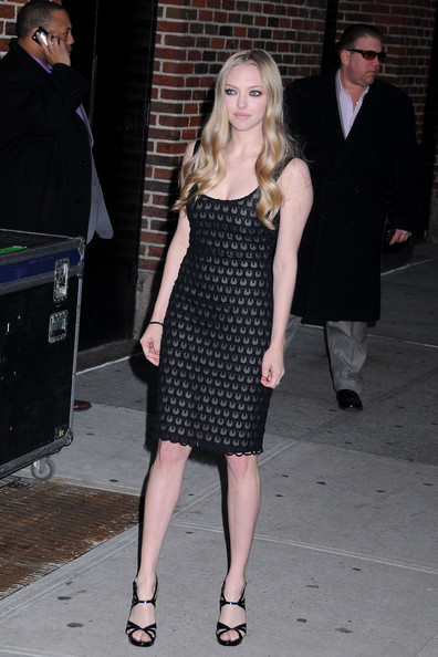"""Red Riding Hood"" star Amanda Seyfried poses for photographs after making an appearance on ""The Late Show with David Letterman""."