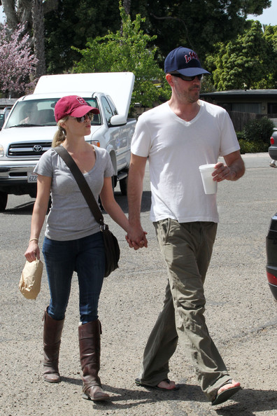 Reese Witherspoon and her boyfriend, Hollywood agent Jim Toth, hold hands on