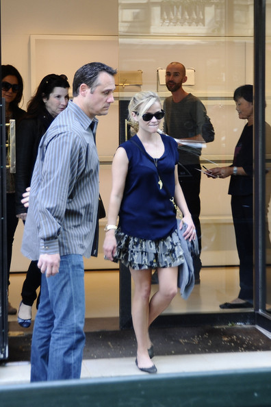 Reese Witherspoon garners attention from streetgoers while out shopping in Paris. The newly married actress, who tied the knot to Hollywood agent Jim Toth, stopped at Celine and the Christian Louboutin stores before going to brunch in a different outfit.