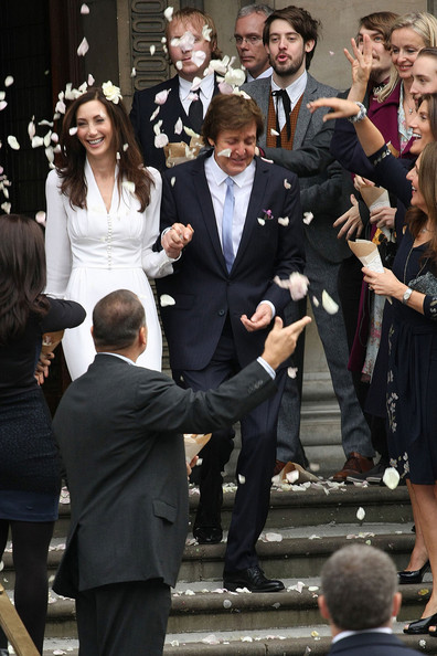 Ringo Starr and wife Barbara Bach at the wedding of Sir ...