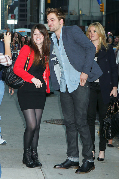 "Robert Pattinson ""Twilight"" star Rober Pattinson stops on the street in New York City to take a photo with a fan on his way to ""The Late Show with David Letterman."" Pattinson is currently promoting the next movie in the ""Twilight"" series: ""Breaking Dawn"" which premieres this week in the US."