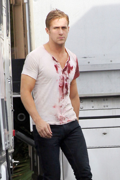 "Ryan Gosling shows of a bloodied shirt while leaving a makeup trailer and heading over to his own on the set the upcoming film ""Drive""."
