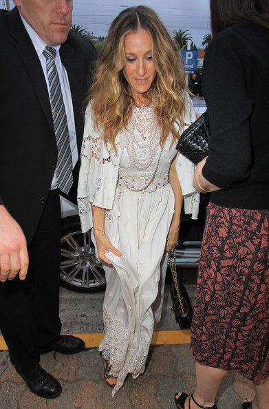 Sarah Jessica Parker shows off her pearls in a white embroidered dress as she arrives at a restaurant in Antibes during the Cannes Film Festival.