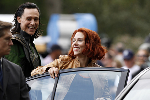 "Scarlett Johansson shares a laugh with Tom Hiddleston on the set of ""The Avengers"" in New York's Central Park."