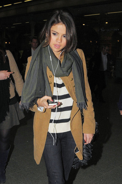 "Selena Gomez Selena Gomez listens to her iPod as she arrives at St. Pancras train station after taking the Eurostar from Paris. Gomez is in London to promote her new album 'A Year Without Rain' and her new season of ""Wizards of Waverly Place""."
