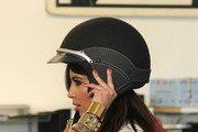 Sexy reality star Kim Kardashian seen joking with her best friend Jonathan Cheban while visiting a Vespa scooter store in Miami. Kim and Jonathan were spotted trying on motorcycle helmets, sitting on various scooters while snapping photographs on Kims iphone before Jonathan took one for a test drive.
