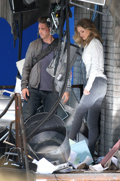 "Shia LaBeouf and Rosie Huntington-Whiteley spend the day working on the upcoming film ""Transformers: Dark of the Moon"". At one point, Shia could be seen hitching a ride on a golf cart from director Michael Bay. Later in the day, LaBeouf and Rosie Huntington-Whiteley filmed a scene together on the set of a destroyed building."