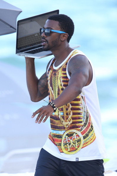 Singer Ray J holding his Macbook like a boombox while taking a walk on Miami Beach. Ray J is in Miami hosting some club nights and filming his new music video.