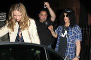Slash, real name Saul Hudson, former guitarist for Guns N' Roses, leaves Cipriani restaurant with British TV presenter Trinny Woodall. Slash is currently married to Perla Feerrar with whom he has two sons.