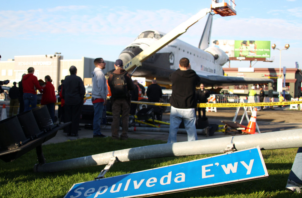 Space shuttle endeavour is seen parked in a shopping for Lax parking closest to airport