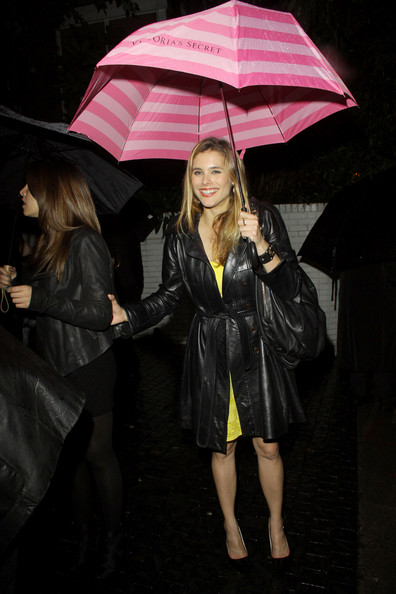 """""""Battle: Los Angeles"""" actress Susie Abromeit is spotted leaving Chateau Marmont on a rainy night with a pink Victorias Secret umbrella"""