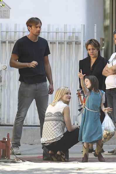 "Swedish hunk Alexander Skarsgard looks to be getting on very well with both his female co-stars on the set of the drama ""What Maisie Knew""! Costumed in some very low-slung jeans, the ""True Blood"" star was spotted playing with his unidentified young co-star in between takes, lifting her up and even letting her climb on his lap for a chat! He was also spied chatting intently to his older blonde co-star as they went to the food tent to catch some lunch. The movie is a modern adaptation of a classic Henry James novel and centres around a wildly disfunctional family."