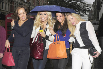 Tara Palmer Tompkinson Celebs Crowd Under One Umbrella in London