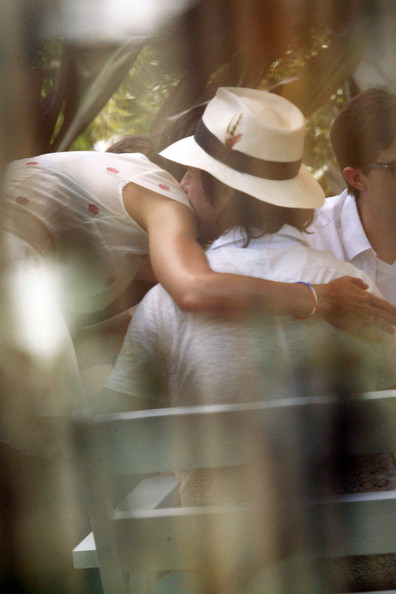 Tom Cruise and Katie Holmes hug and kiss as they celebrate Tom's 49th birthday with friends and family in South Beach. The party, which was reportedly a surprise party, was quiet and private with Cruise's son Conner in attendance.