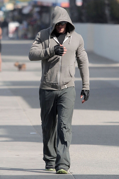 """Twilight"" start Kellan Lutz stays low key in a hooded sweater while doing a light workout routine in Los Angeles.  Lutz recently released a 25-piece men's ready-to-wear collection from the new line Abbot + Main, which he is also the co-founder."