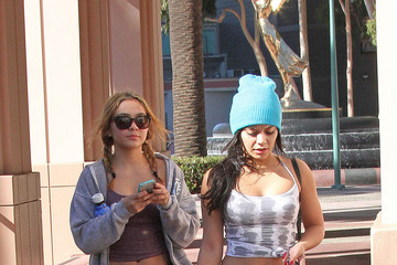 Vanessa Hudgens Vanessa Hudgens, sporting a bright blue knit hat, crop top and black pants, goes out and about with her sister in Los Angeles