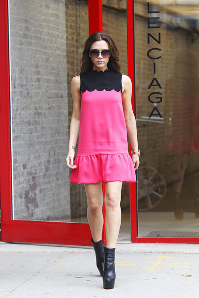 Victoria Beckham Proud mother Victoria Beckham takes her daughter Harper for his first shopping trip to the Prada store on New York City's prestigious 5th Avenue. The former Spice Girl sported a pink dress with stiletto heels as she walked past dozens of fans awaiting her Fashion Week appearances after she attended a show at the NYC Library. She later lunched at Balthazar in SoHo.