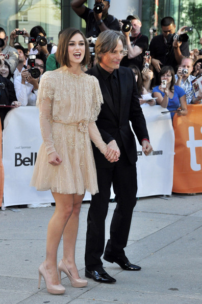 "Viggo Mortensen Keira Knightley and co-star Viggo Mortensen link hands at the premiere of ""Dangerous Method"" at the Toronto Film Festival."