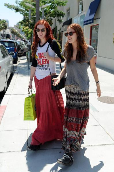 Willis sisters! Rumer Willis and her sisted Tallulah Belle go shopping in Beverly Hills before driving off in a smashed up BMW. The girls dressed in a hippie style, with both sisters wearing long skirts and bracelets and Rumer wearing a Van Halen shirt.