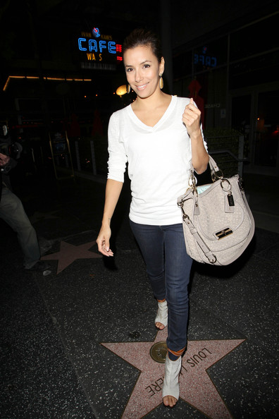 A beaming Eva Longoria steps